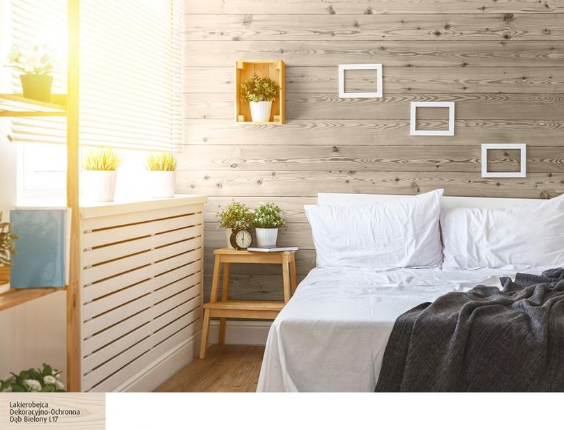 Drewno na ścianie wskandynawskiej sypialni